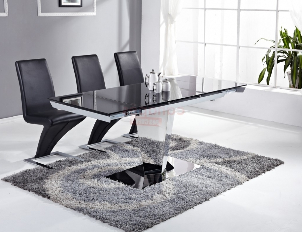 Chaise table a manger design le monde de l a for Table noir salle a manger